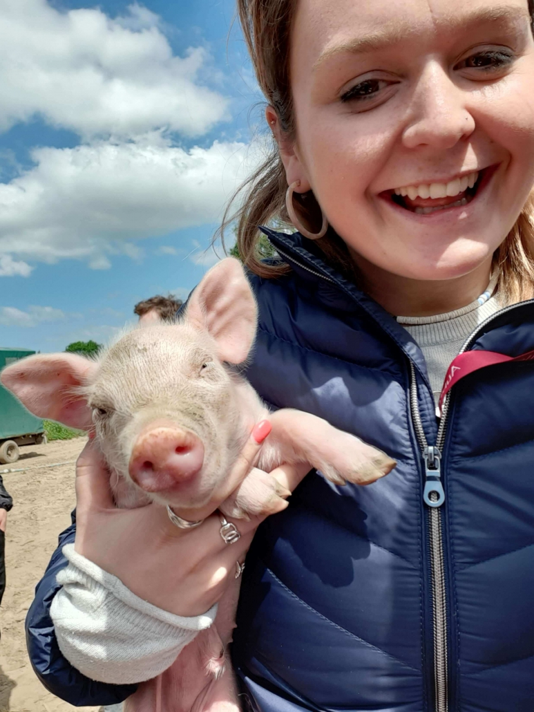 Verity Taylor at Aubrey Allen with a Free Range Blythburgh Piglet